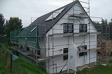 Wohnhaus-mit-grundstueck-bauen Neubau eines Einfamilienhauses